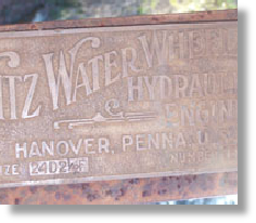 Fitz copper nameplate on his waterwheel