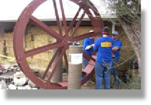 Extreme Home Makeover Installation of a waterwheel
